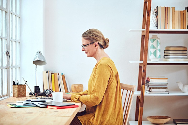Woman working from her home office