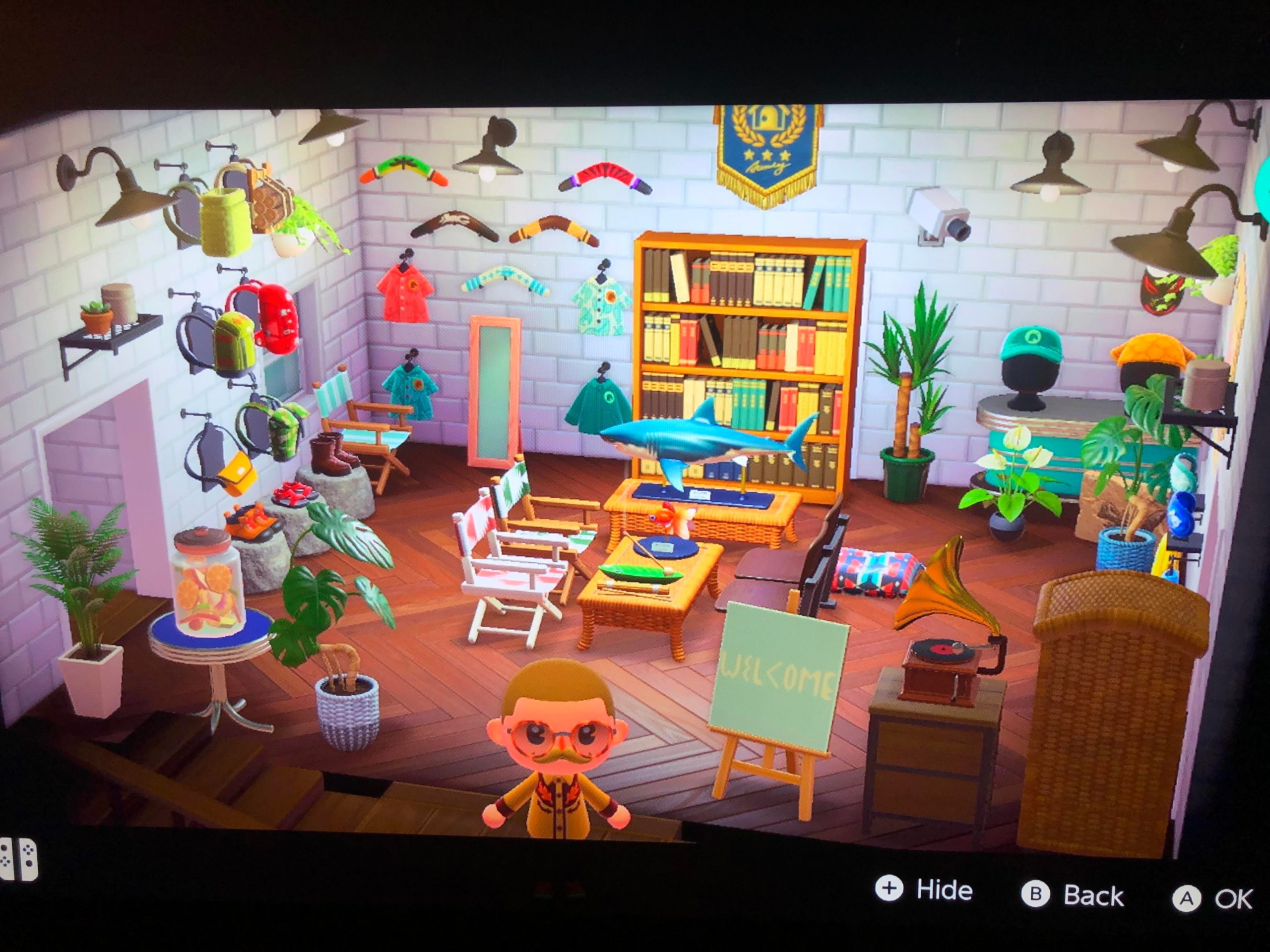 the first room In my house is the nook visitor center on the island. I also have rick and mortys garage, a corrupt office space, Salvador Dali basement, and a nice bedroom. Just paid off my home loans and can finally get creative with my spaces! Hope everyone is coping alright in these tough times. : AnimalCrossing