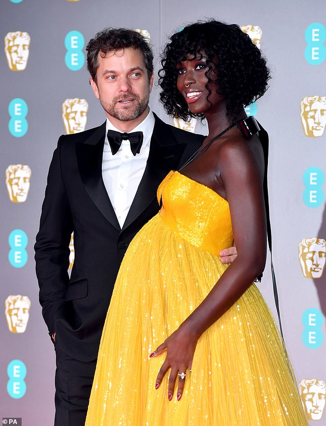 First-time parents: Jodie told how she and Joshua (pictured at the BAFTAs in February) were 'concerned about negative birth outcomes for black women in America' and had a home birth