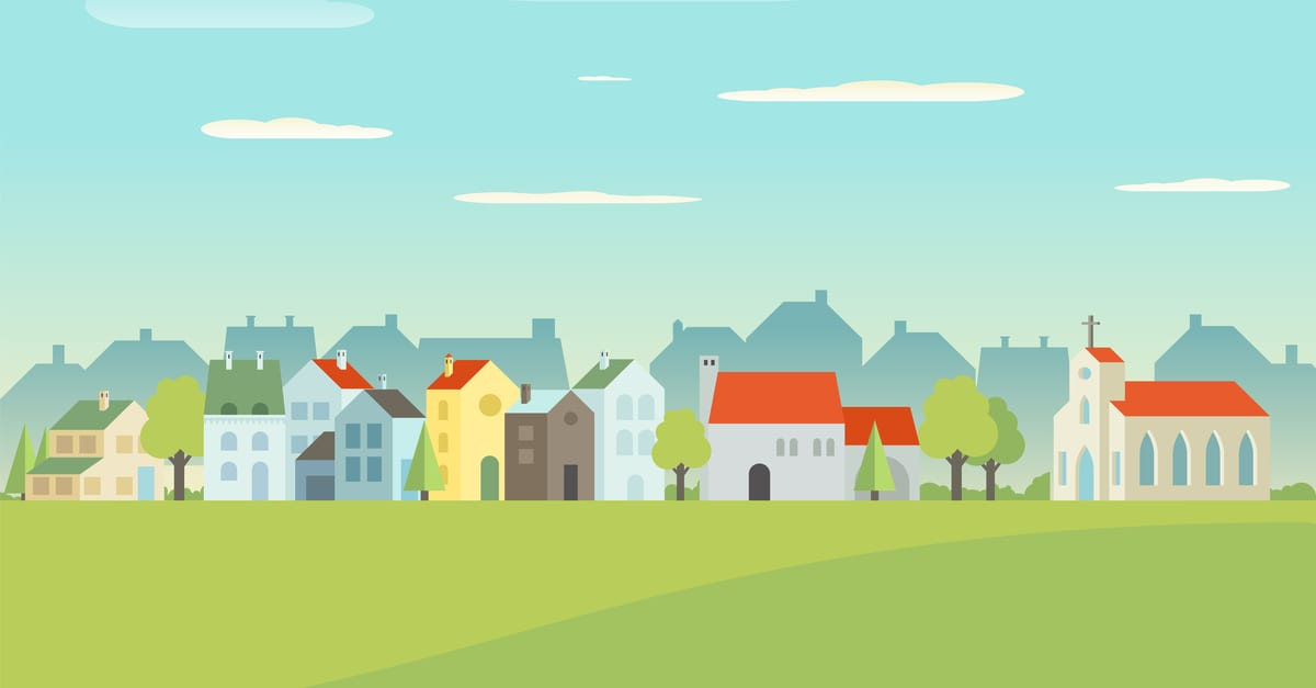 A bunch of multi-colored homes with grass and a blue sky