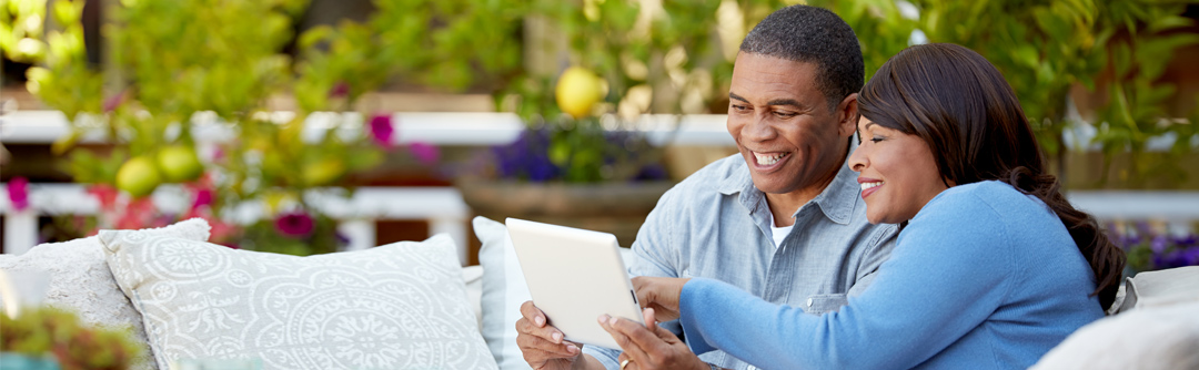 image of man and woman looking at tablet